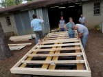 Bracing the floor frame to the trailer decking