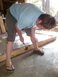 Hammering the Flashing with Roofing Nails