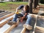 """Securing the Floor Frame to the Trailer Decking with 3"""" Deck Screws and Metal Bracing"""