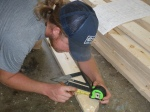 Figuring out the notch in the rafters for the wall frame