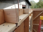 These spacers are installed between the loft framing and the small shelf frame at the front of the tiny house to be able to put up the top of the header that the rafters will ultimately rest on...