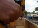 """'Toe-nailing' in the spacers with 3 1/2"""" deck screws"""