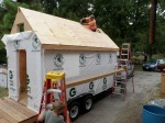 Roof sheathing completed.