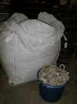 Loading the wool into a large tub to carry to the Tiny House for stuffing in the walls...