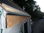 The drip guard in place along the edge of the roof plywood and cedar 1x6 facia to prevent water from dripping over the edge of the roof...