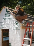 """Gabby installing the 1x6 spacer boards with 2"""" deck screws."""