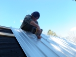 """Screwing down the metal sheeting with 2"""" sheet metal screws and the IMPACT DRIVER.  A must-have!"""