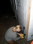 Gabby pre-drilling the 1x4 Cedar Corner Trim