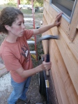 Hammering in the twisted shank, tripple galvanized siding nails...