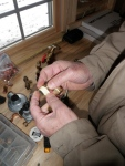 Preparing brass pipe fittings with teflon tape to prevent any gas leaks...