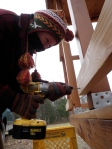 "Securing the lower cedar 2x4 railings with 3"" coated deck screws."