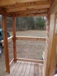 Left side of porch.