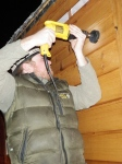 """Cutting a 3"""" hole for the boat furnace exhaust 'chimney'."""