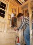 """Running 3/8"""" soft copper gas line to the furnace."""