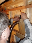 Securing the vent pipe to the interior of the 'chimney'.