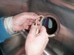 Putting a ring of plumber's putty around the drain hole in the bottom of the sink to create a water tight seal...