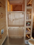 The kitchen side of the shelving unit beginning to take shape.
