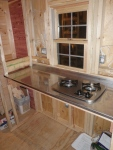 Stove side ready for knotty pine on the walls, and cabinetry beneath.