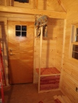 Cats' litter box cubby lined with aromatic red cedar to help cut down on the litter box smell in the tiny house...