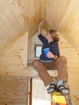 Applying the tongue oil finish on the entry way storage loft.