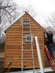 Corner trim going up on the back of the tiny house.