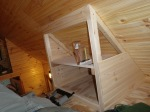 Knotty pine going up on closet end.
