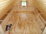 Finishing the foot lockers with the knotty pine tongue and groove.