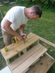 """Securing the steps with 3"""" coated deck screws."""