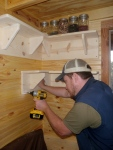 Installing more hand-made 1X8 pine shelving.